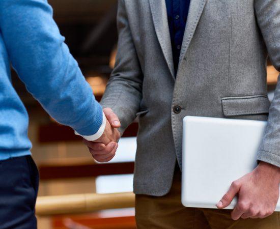Business People Shaking Hands Indoors